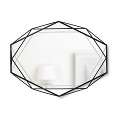 Spruce up your home and reflect your style: Add the illusion of space to even the coziest settings with Umbra's Prisma Hanging Wall Mirror. This mirror makes a decorative statement and packs a punch with brass details and a lateral border. Modern and functional, perk up smaller spaces with this update to the sunburst classic.