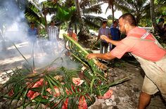 Lovo -- a traditional Fijian cooking method used for celebrations like weddings and festivals. Meat, fish and vegetables are wrapped in banana leaves and cooked on stones