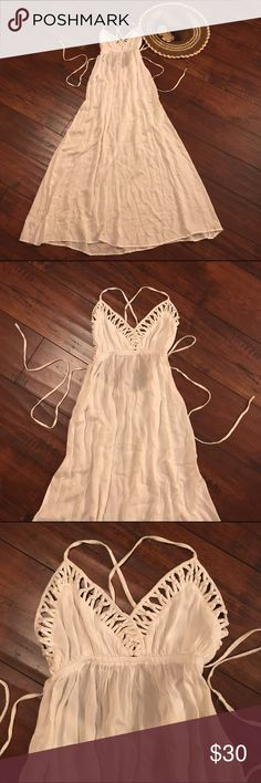 Absolutely stunning white boho dress!💕 Absolutely stunning dress!💕 I HAVE 2 OF THESE DRESSES!💕 SEE MY OTHER LISTING! Be warned ladies, this dress is very light! I recommend a silicone bra and nude undies. Unlike the other dress posted, this one does not have a tear. The size reads M but will fit a S just as well! The back of is my favorite part of this dress, it still has its tags, has never been used and the white is so bright and vivid!💕 Dresses Maxi