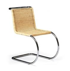 A designer favorite for transitional settings: Mies van der Rohe's Cantilever Chair in cane. Bauhaus designer Lilly Reich designed the wickerwork on this version.