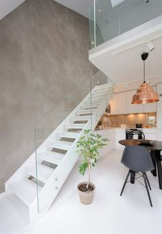 Modern corner,  Concrete wall , copper, black & white furnitures