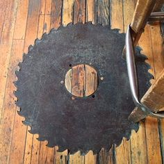 Saw blade inlay in wood floor --- this would be really great as a table top!!!