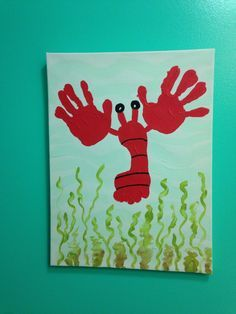 I created this simple craft idea with my daughters foot and two hands dipped in red paint to create this lobster that fits perfectly in her under the sea themed bathroom.