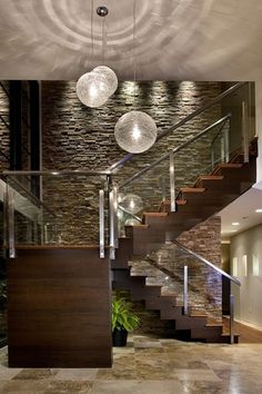 Contemporary Staircase with Hardwood floors, Ply Gem Stone True Stack Stone Veneer Calgary, High ceiling