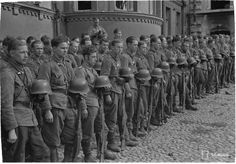 Finnish soldiers gathered at a ceremony in Viipuri, 31 August 1941. Large parts of Karelia were ceded by Finland to Russia at the end of the Winter War, retaken by the Finns in 1941 and again ceded to Russia at the end of WWII. The Finnish Karelian population (over 400 000) was evacuated to other parts of Finland in 1944 and Karelia was resettled by the Slavic population.