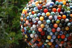 Reclaimed Marble Garden Ball. Made with vintage marbles! LOVE this !!(: Must go to flea markets for marbles and make one...or two...