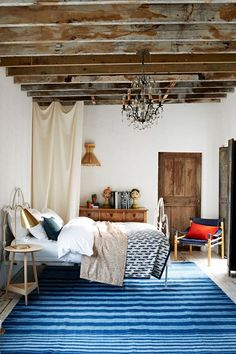 Discover bedroom design ideas on HOUSE - design, food and travel by House & Garden. A Mediterranean-inspired selection of wood and antique metal furniture.