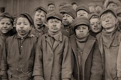 The History Place - Child Labor in America 1908-12: Lewis Hine Photos - Miners. Miners: Breaker boys. Smallest is Angelo Ross. Pittston, Pennsylvania.