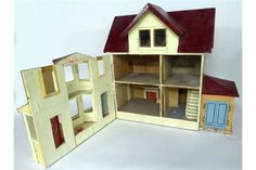 20th CENTURY PAINTED WOODEN DOLLS HOUSE WITH GARAGE