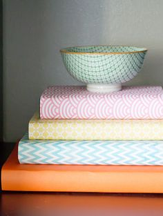 Covering books in colourful fabric... perfect non-commital way to add colour to my home