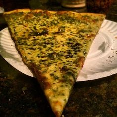 The best pizza place in Queens has been around since 1959. And their best slice of pizza is the pesto slice.   Pesto Slice at Dani's House Of Pizza | 39 Delicious New York City Foods That Deserve More Hype