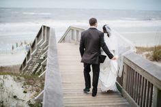 Freshly wedded couple. Beach Wedding. Winter wedding.
