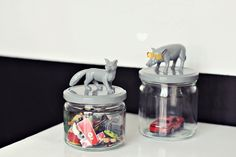 jars with plastic animals..glue animals to lid & spay paint. I would use bright colors..