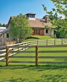 """The Beechwood Stables complex consists of three buildings; a riding arena, a horse barn and a service barn. The arena is fronted by a tall porch with a monumental fireplace framed by granite and Douglas fir columns and a ridgeline skylight. The porch leads to an observation room overlooking the arena. Horizontally bi-folding """"hangar"""" doors along the arena's perimeter provide extraordinary light, views and ventilation. An enclosed link between the arena and stall barn accommodates space for a…"""