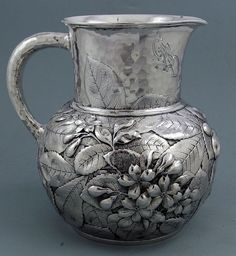 Whiting hammered sterling silver water pitcher, with floral and fruit motifs and an interesting monogram, c1880 (Britannia Silver)