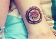 camera aperture tattoo - would never get... But it's a cool idea!
