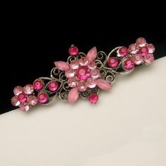 PRETTY PINK SATIN GLASS! Gorgeous bar brooch with pink satin glass and pink rhinestones, $39.95