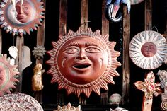 terracotta suns on wall