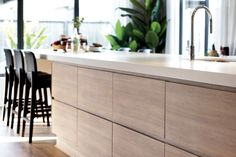 An extra-long kitchen island with clever storage solutions and a breakfast bar at the end Kitchen With Long Island, Long Kitchen, Kitchen Island, Single Storey House Plans, Porter Davis, Copenhagen Style, New Home Designs, Highlands, Storage Solutions