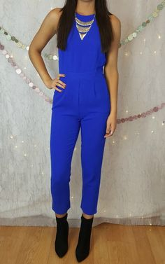 Cobalt Blue Jumpsuit by Sugarlips. Cropped jumper with cutouts in back.