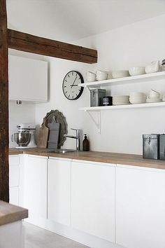 white kitchens - i like white cupboards and timber tops