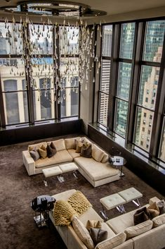 The gorgeous champagne-hued living room in a $25,000/night suite at the Lotte New York Palace Hotel.