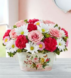 Set someone's heart aflutter with our Delightful Day™ Bouquet! It features a cheerful mix of pink and white blooms, accented with a graceful butterfly pick. Best of all, it's nestled in our exclusive keepsake planter Pink And White Flowers, All Flowers, Pretty Flowers, Online Flower Shop, Order Flowers Online, International Flower Delivery, Balloon Flowers, Mothers Day Flowers, Christmas Centerpieces
