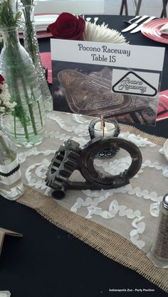 Car parts make the perfect table number holders for a race themed wedding reception!