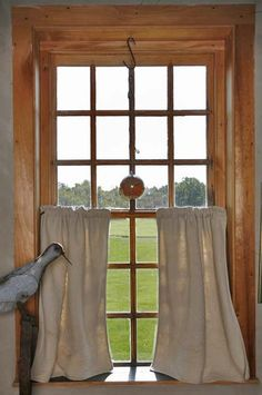 Looking out from a primitive style house in Vermont. See the August 2013 issue. #primitive #window #earlyamericanlifemagazine