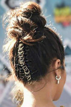 Hair jewelry and baubles have always been around, but pierced braids have not. Many credit Shay's hairstylist, Chris Appleton, for bringing this bold hair trend into the public eye. Watch us try it ourselves here.