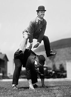 Stan Laurel and Oliver Hardy, Hal Roach M-G-M famous comedy team indulge in a game of leap-frog. 1936