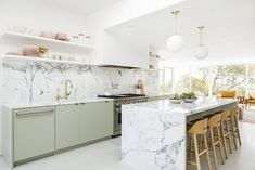 Mandy Moore's home designed by Sarah Sherman Samuel. Photography by Trevor Tondro. Countertop Concrete, Kitchen Countertops, Marble Counters, Calacatta Marble, Kitchen Cabinets, Kitchen Island, White Counters, Upper Cabinets, Modern Cabinets
