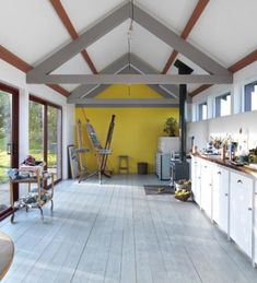 Yellow Accent Wall, White Wood Floors, Lots of Natural Light // bright