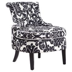 I love basic black and white in home furnishings - especially when there's a floral motif. This chair is just awesome! It looks too fancy to serve as a resting place for the human rear end, LOL!