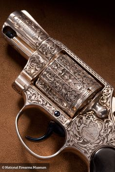 Colt .38 Detective Special – The Ultimate Sidearm for any Vampire Hunter, this Elaborately Engraved Silver Plated Revolver is Fitted with a Coffin Shaped Ebony Case that Holds Holy Water, Mirror, a Wooden Stake and Silver Bullets cast in the Shape of Miniature Vampire Heads. Done by Master Engraver Wayne D'Angelo. (Price $8,950.00)
