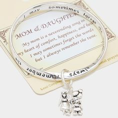 """""""Mom & Daughter"""" Antiqued Bangle Bracelet Just in time for Mothers Day - this is a beautiful antiqued twisted silver tone bracelet with a special message for Moms. There is a mother daughter silver tone charm. 2.5"""" diameter. Jewelry Bracelets"""
