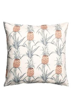 Cushion cover in patterned slub weave cotton with a concealed zip.