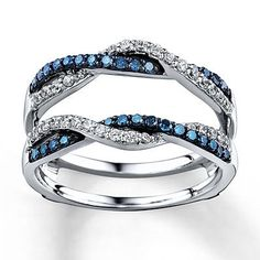 Waves of blue and white diamonds criss-cross in this irresistible enhancer ring. With a total diamond weight of 1/2 carat, the ring is styled in 14K white gold. (The diamond solitaire ring is sold separately.) Blue diamonds are treated to permanently create the intense blue color.