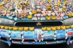 Image: 'ChewBaru' Subaru art car at Fremont Fair in Seattle (© Crystal Lynn Hoeveler).. Week 53: The 'ChewBaru' art car on display at the Fremont Fair in Seattle. The Subaru is covered with more than 70 pounds of old dentures, toothpaste tubes and other dental accessories. When it isn't traveling to art car shows throughout the United States, the ChewBaru resides in Great Bend, Kansas.