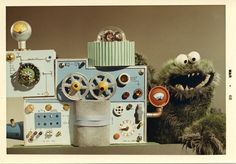 """Sesame Street's Cookie Monster started out life as something rather different. Being one of three monsters designed by Henson for TV commercials, the Cookie Monster was originally green with large teeth and was known as the """"Wheel Stealer."""" He made his actual TV debut in 1967 where he devoured a complex coffee making machine as the machine described it's various components."""