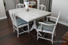 Double pedestal white table and chairs