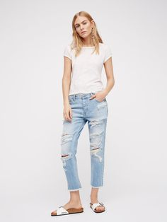 Kick Crop Jean | Super distressed boyfriend jeans featured in a cropped inseam.      * Slouchy fit.    * Raw hem.    * Button fly.    * Five-pocket style.