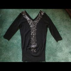 Black sweater blouse with sequins Black with sequins sweater blouse, nice with leggings. 52% Ramie, 28% Cotton & 20% Nylon. There are few missing sequins but not noticeable. Cool Attitudes Tops Blouses