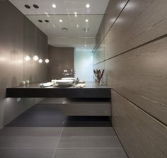 Love the timber panel on the wall, large format tiles on the floor and lighting.
