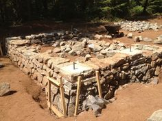 Great information on how to build a stone foundation for cob home!