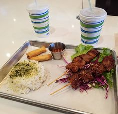 'Pecan Smoked Skewers' bbq pork rice lettuce purple cabbage. Quite fatty but oh so delicious. Try this place (or food the food truck)! . . . #flippinpatties #philipino #philipinofood #pork #bbq #grandopening #brickandmortar #ighouston #enjoylife #foodies #foodstagram #foodphotography #instafood #yum #nomnom