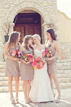 Neutral bridesmaids with colorful bouquets! LOVE.