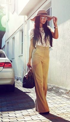 A high waisted, wide leg pant is always so chic. Pair them with a girly top and wedges to compete the look!