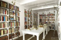Entry turned library in Luis Bustamante's apartment in Madrid