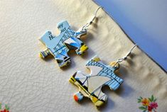 Recycled jigsaw pieces, now being used as earrings. (Recyclart, 2012)